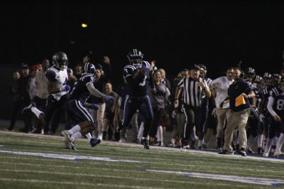 Sophomore running back No. 3 Rhamondre Stevenson breaking through and running the ball down the field for a big gain to move Cerritos into scoring position. Photo credit: Carlos Ruiz & TM Archives