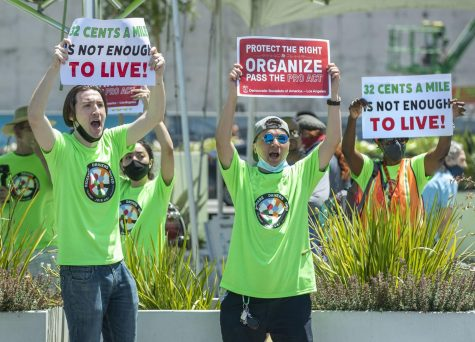 Proposition 22 faces a potentially long legal battle after a judge called the gig-worker law unconstitutional. Above, ride-hailing drivers and organizers rallied at a drivers strike at the Los Angeles International Airport in July. Photo credit: Mel Melcon/Los Angeles Times/TNS