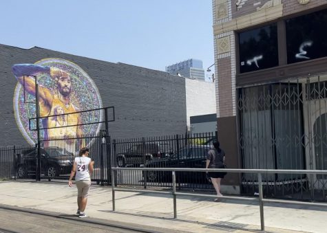 Bystanders photographing the Kobe Bryant Mural. This was located on 1348 Flower St, Los Angeles, CA 90015