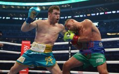 Canelo Alvarez punches Billy Joe Saunders during their fight for Alvarezs WBC and WBA super middleweight titles and Saunders WBO super middleweight title at ATandT Stadium on Saturday, May 8, 2021 in Arlington, Texas. (Al Bello/Getty Images/TNS)