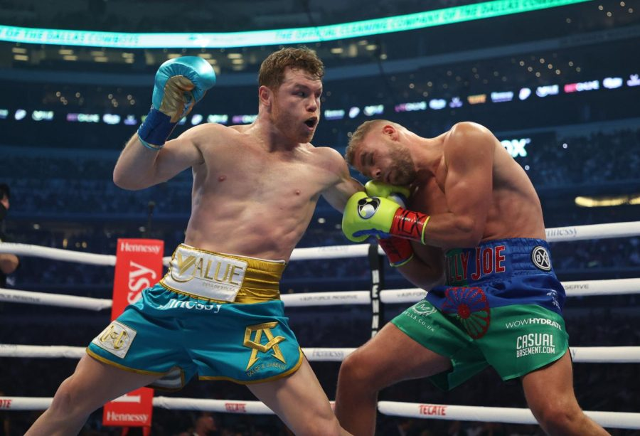Canelo+Alvarez+punches+Billy+Joe+Saunders+during+their+fight+for+Alvarezs+WBC+and+WBA+super+middleweight+titles+and+Saunders+WBO+super+middleweight+title+at+ATandT+Stadium+on+Saturday%2C+May+8%2C+2021+in+Arlington%2C+Texas.+%28Al+Bello%2FGetty+Images%2FTNS%29