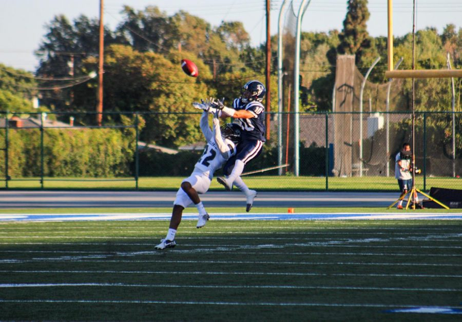 Falcons Wide Receiver Bailey Torres Jumps up in an attempt to make the catch. He is in coverage against a Fullerton Defensive back during the game on Sept. 11, 2021.