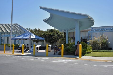 Check-in stations are placed throughout Cerritos College to ensure that students and staff do not have symptoms of COVID-19. The Board of Trustees will mandate the COVID vaccine or a weekly negative test on Oct. 1, 2021. Photo credit: Vincent Medina