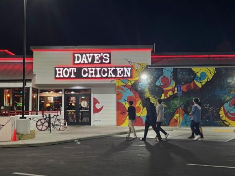 Customers walk to the new Daves Hot Chicken location which opened on Sept. 12. There were busy lines inside the red-lit store with customers eager to try spicy chicken. Photo credit: Fatima Durrani