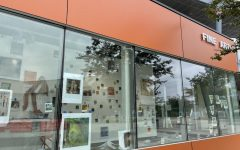 Christopher Anthony Velasco's art titled Forbidden Photos Of A Doctor Above Suspicion is displayed in the windows of the Fine Arts building at Cerritos College. This exhibit runs from Aug. 30-Sept.11 2021.