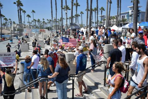 Protestors in Huntington Beach resist mask mandates and spread disputed information about the COVID-19 vaccine during the Freedom Rally on Aug. 29, 2021. The rally attracted conservative politicians who encouraged people to fight back against the government.