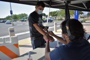 Cerritos College student confirms he has no symptoms of COVID-19 at a health screening kiosk. The college reported that 39 cases of COVID were found on campus as of Sept. 16, 2021.