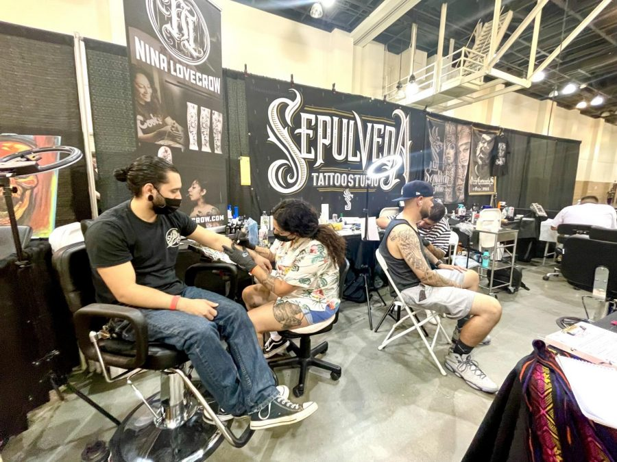 Booth for Sepulveda Tattoo Studio that specializes in custom original tattoos. Nina Lovecrow tattooing her client, her speciality is also fine line tattoos, photographed on Sept. 19, 2021.