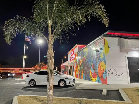 Decorated with a beautiful mural and neon red lights, Dave's Hot Chicken attracted so many cars that an entire lane on Clark Ave. was blocked.