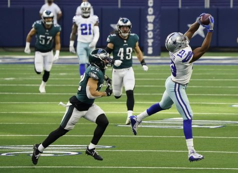 Dallas Cowboys wide receiver Amari Cooper (19) hauls in a long pass against Philadelphia Eagles safety Marcus Epps (22) during the first quarter of an NFL football game at AT&T Stadium on Sunday, Dec. 27, 2020, in Arlington. Photo credit: Smiley N. Pool/The Dallas Morning News/TNS