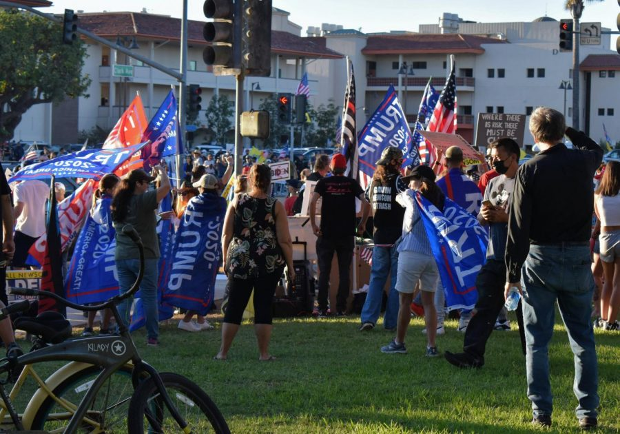 Trump supporters protest across the street from Long Beach City College. Many claim the election was stolen by Joe Biden, who rallies with Governor Newsom at the college on Sept. 13, 2021.
