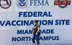 A vaccinated person leaves the FEMA operated vaccination site at Miami Dade College - North Campus in Miami on Monday, April 5, 2021. Florida is now seeing a record number of deaths as the delta variant continues to surge through much of the U.S. Photo credit: Daniel A. Varela/Miami Herald/TNS