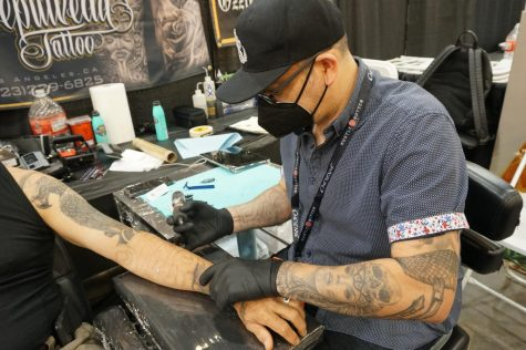 Victor Sepulveda tattooing on his clients forearm. His career spans over 25 years in the tattoo industry taken on Sunday Sept.19, 2021.