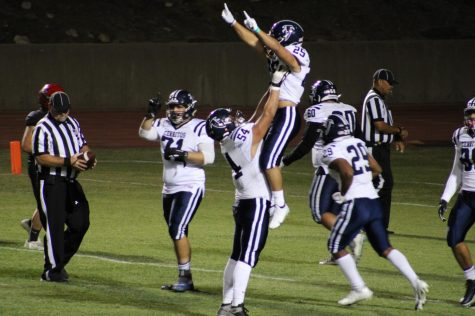 Falcons RB Penieli Lauago (#25) is lifting into the air by OL Jonathan Manzo (#54). Penieli caught a 37-yard touchdown pass to give the Falcons at 33-17 lead in the 4th quarter of their game at Chaffey College on October 16th. Photo credit: Robert Yeutter