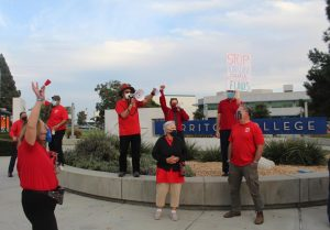 Cerritos college faculty and staff picket on the corner of Alondra and Studebaker during contract negotiations with the college on Oct. 6, 2021. The district wants to implement a CAP on healthcare plans that will increase premiums raising the costs for full-time employees.