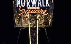 Norwalk Town Square sign that stands tall in the city of Norwalk. The sign lights up in the night as it displays in the center of the Norwalk Community on April. 26th, 2020 Photo Credit: Roman Acosta