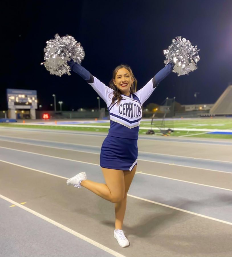 Abigail Covarrubias, 20, is grateful to be back at Falcon Stadium cheering as Cerritos Sports resumes action after an entire season away due to COVID-19. Abigail is excited to be back under the lights on Saturday nights cheering on for the Falcons Football team. Photo Credit: Courtesy of Abigail Covarrubias