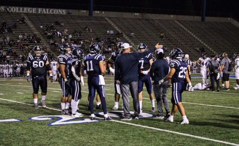 Before the football team was shut down on September 24. The coach is seen orientating his players on the field September 11.