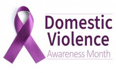 Purple ribbon on white background, top view. Symbol of Domestic Violence Awareness Photo credit: Copyright: Belchonock/@123RF.com