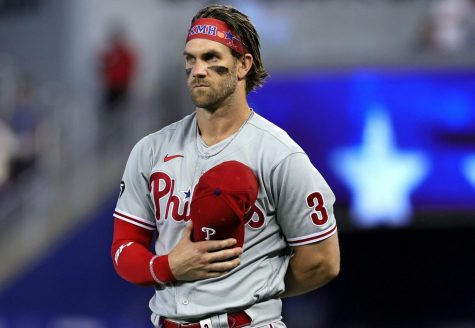 Philadelphia Phillies right fielder Bryce Harper (3) listens to the national anthem before the start of a baseball game against the Miami Marlins at loanDepot park on Sunday, September 5, 2021 in Miami, Florida. (David Santiago/Miami Herald/TNS) Photo credit: David Santiago/Miami Herald/TNS