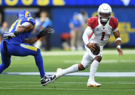 Arizona Cardinals quarterback Kyler Murray scrambles for a first down against Los Angeles Rams linebacker Kenny Young in the second quarter at SoFi Stadium on Sunday, Oct. 3, 2021 in Inglewood, California. (Wally Skalij/Los Angeles Times/TNS)