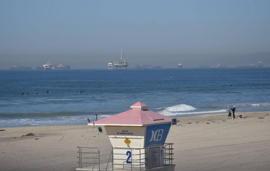 Huntington Beach lifeguard tower two overlooks an oil drilling site. The beach reopened after a drilling site off the coast released about 126,000 gallons of oil into the water on Oct. 3, 2021. Photo credit: Vincent Medina